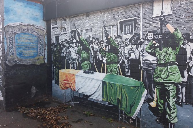 Depiction of a mural honouring an IRA soldiers passing with a 21 gun salute
