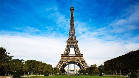 Image of the Eiffel Tower with a beautiful blue and cloudy sky as the backdrop
