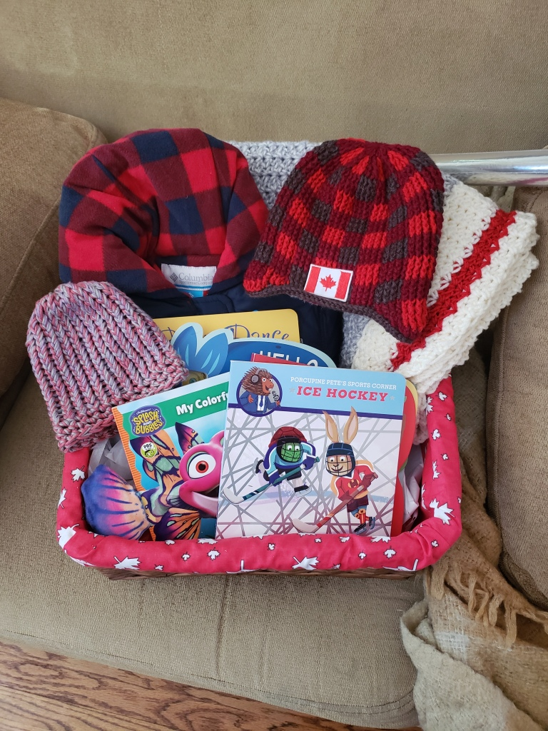 Canadian Baby Gift Basket with snowsuit, crochet hat and blanket, 1 knit hat and 5 board books