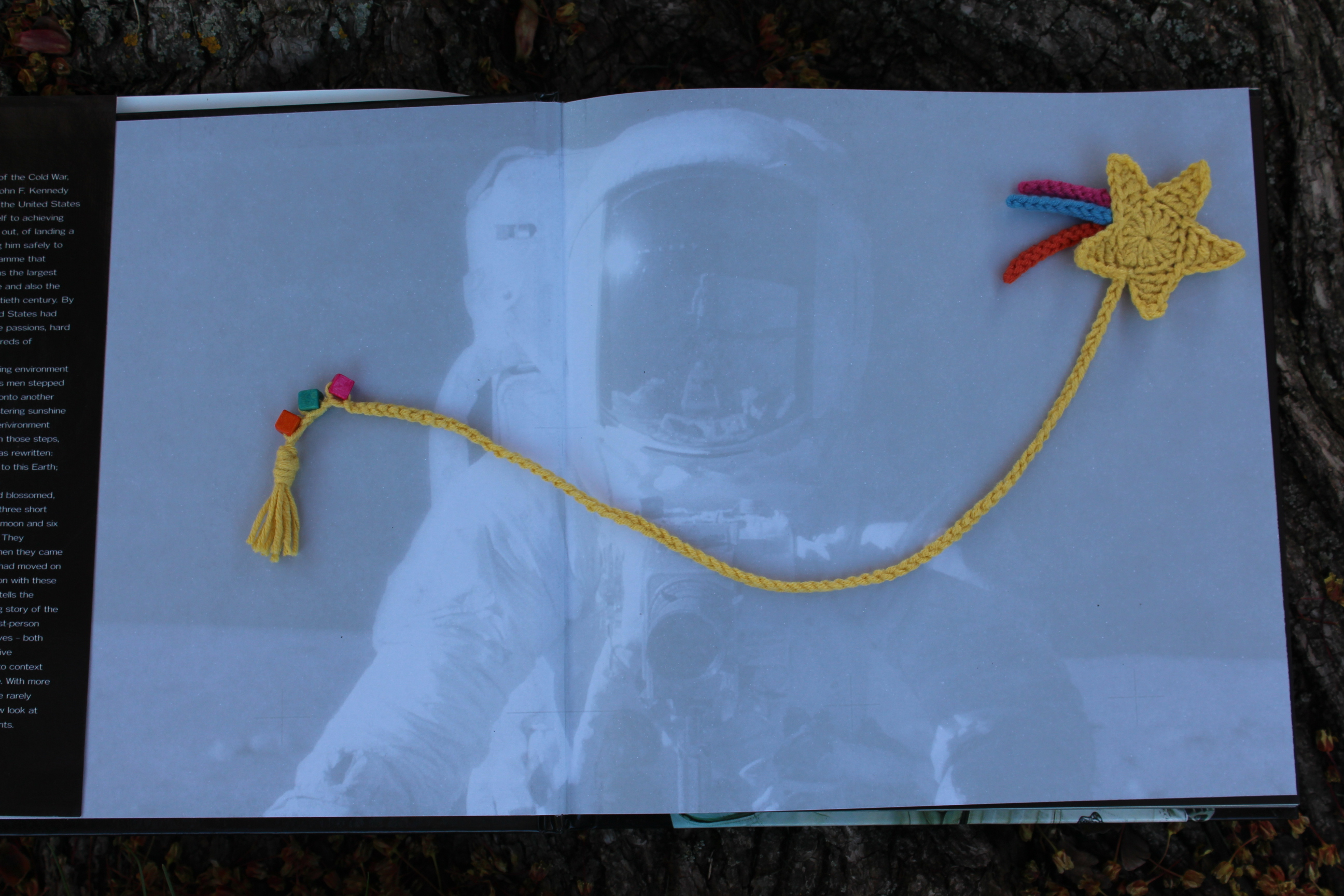 Shooting Star crochet bookmark being displayed on the first pages of the book Destination Moon.