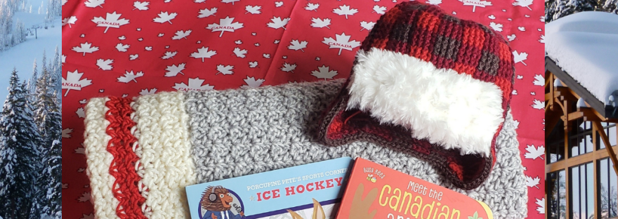A crochet work sock style blanket with a buffalo plaid trapper hat, and two Canada-themed board books, photographed on red fabric with white maple leafs pattered across it, with a backdrop of the Canadian North in the Winter at a chalet, says: 'It's Canada Day! Visit peachybooks.ca to see a sweet list of Canadian board books for babies!'