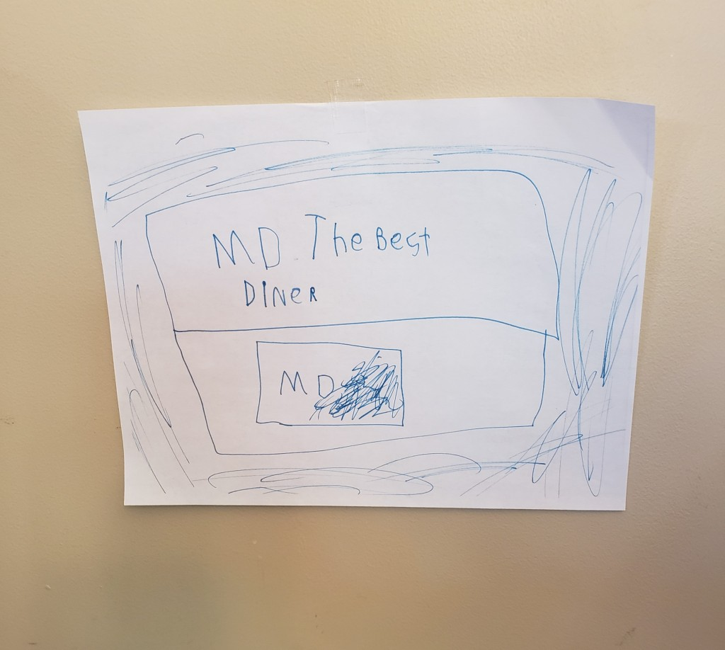 Sign in child's printing that says: MD The Best Diner
