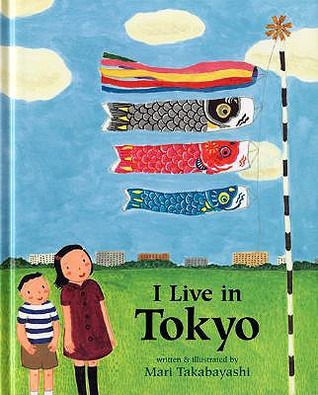Book Cover for I live in Tokyo by Mari Takabayashi showing a Japanese boy and girl admiring a flagpole displaying 4 kites, 3 of which appear to be fish