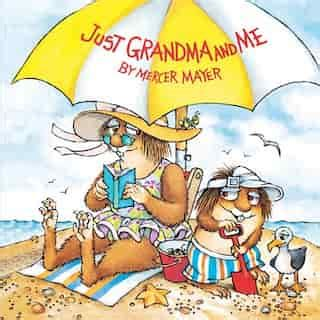 Book Cover for Just Grandma and Me by Mercer Mayer showing grandma and little boy critter at the beach under a yellow and white striped umbrella; grandma reading a book and little critter playing in the sand with a pail and shovel