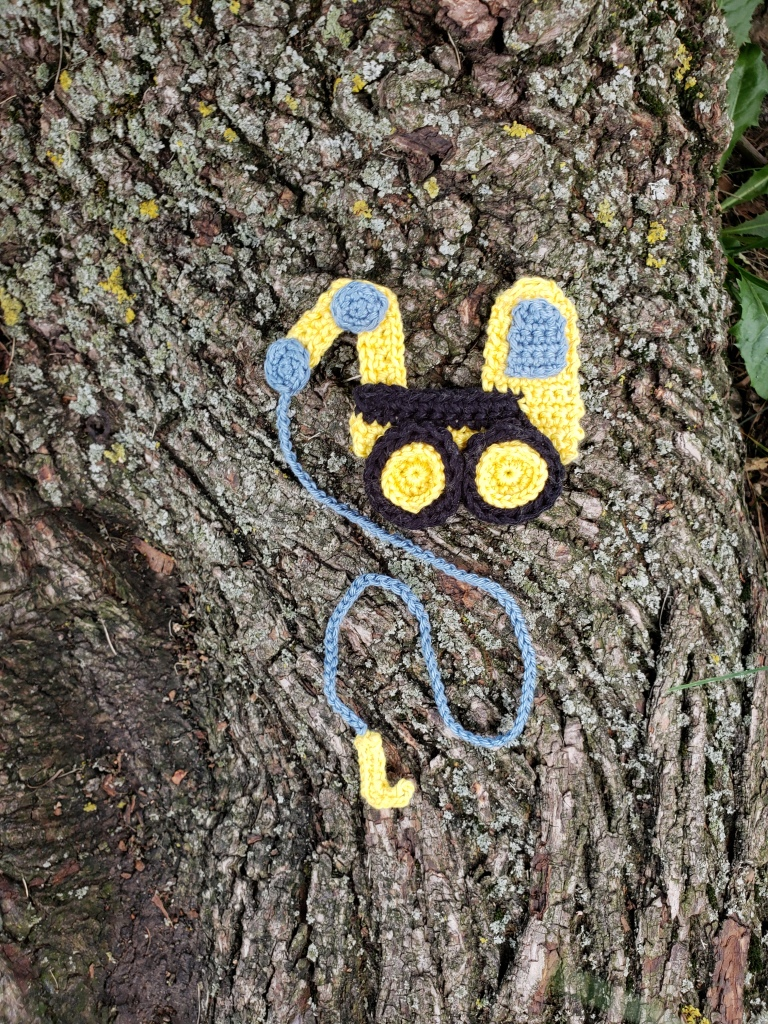A crochet crane bookmark