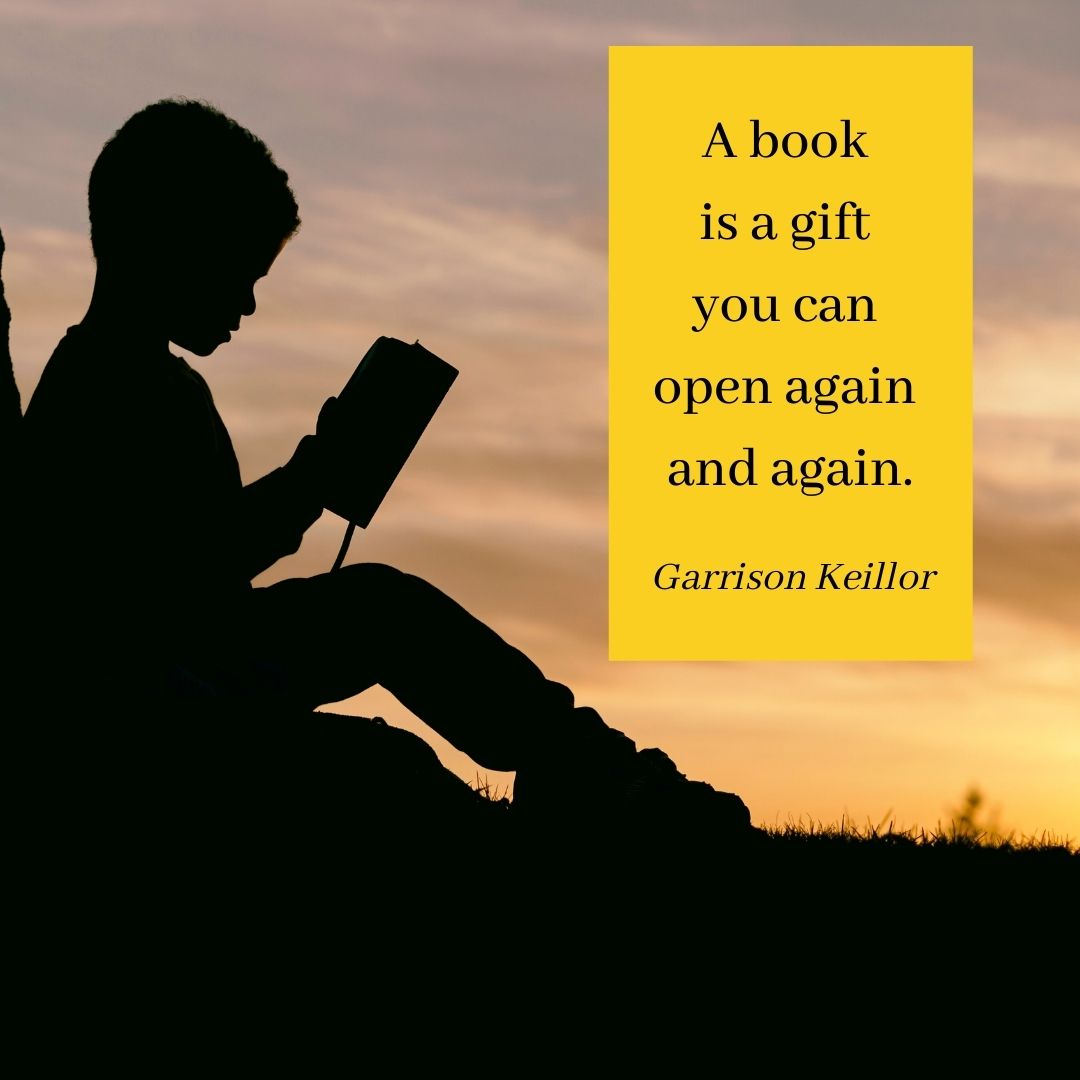 A silhouette of a boy reading a book on the grass at sundown, with the quote: A book is a gift you can open again and again by Garrison Keillor